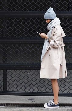If you don't mind the cold too much, the above Converse outfit works. Wear your them with a trench, grey scarf and beanie. Via Unknown Blogger