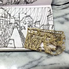 Jonathan Boyd showing us his original sketches for this beautiful gold brooch -  you can see Jonathan til 4pm today at #GoldsmithsFair Week 1  #jewellery #jewelry #design #sketch #drawing #sketchbook #gold #brooch #handmade