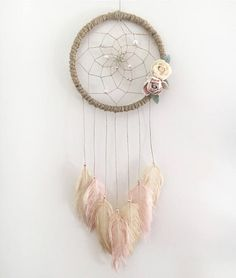 This beautiful medium sized 7 dream catcher would be the perfect addition to any living space! This catcher is part of our Romance Collection and is suited for all ages. It has been hand crafted with love and good intentions. Materials include a natural jute wrapped hoop with twine