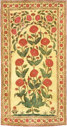 An Embroidered Wall Hanging   India, Post Moghul, 19th Century   Finely embroidered with a stem of blossoms rising from water beneath a leafy arch, all within corresponding flower scroll borders on a cream ground  99 x 52 in. (251.4 x 132 cm.)