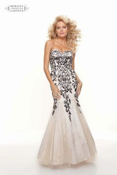 A beautiful slim fitting gown with lace on net over charmeuse. Crystal beading adds an extra sparkle to this Mori Lee prom dress.