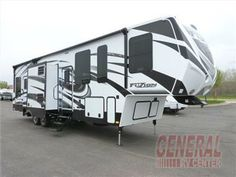 """A place for the toys to travel securely also becomes additional living space in this Fuzion 342 toy hauler fifth wheel by Keystone RV.     Enter the 8' rear ramp door to make loading a breeze into the 12' cargo garage which includes a side man door also. There is also a 40"""" loft that the kids will love. You will also find in the cargo area an LCD TV for enjoyment, a washer and dryer prepped space and a locker for storing some gear."""