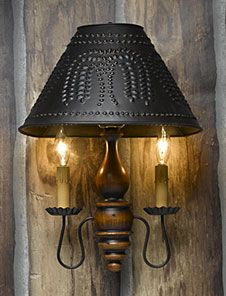 Love this sconce with the punched tin shade