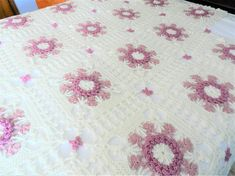 Lacy mauve and creamy white crocheted afghan