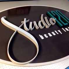 Dimensional sign, hdu sign foam oval and brushed aluminum composite cnc router cut and mounted atop a digitally printed background, hand painted elements