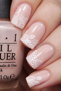 Give life to your nude nails by adding white polish on the tips with flower details on them. Nude Nail polish: Always trending Owing to the fast changing trend of nail art, you might find… Continue Reading → Beautiful Nail Art, Gorgeous Nails, Pretty Nails, Bridal Nail Art, Bridal Nail Design, Lace Nails, Lace Nail Art, Nagel Stamping, Nail Design Spring