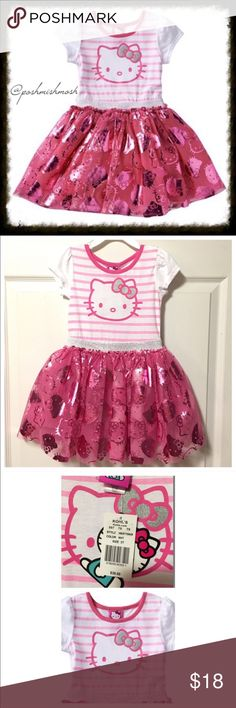 NWT Hello Kitty Foil Dress 3T NWT Hello Kitty Foil Dress 3T. She'll indulge in the shimmery look of this gorgeous Hello Kitty striped tutu dress. In pink/white.  Crewneck, Short sleeves, Fluffy ruffled skirt, Glitter belted accent. Cotton, polyester. Machine wash. Hello Kitty Dresses