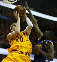 Golden State Warriors' Draymond Green (23) fouls against Cleveland Cavaliers' Timofey Mozgov (20) in the fourth quarter of Game 4 of the NBA Finals at Quicken Loans Arena in Cleveland, Ohio, on Thursday, June 11, 2015. (Nhat V. Meyer/Bay Area News Group)