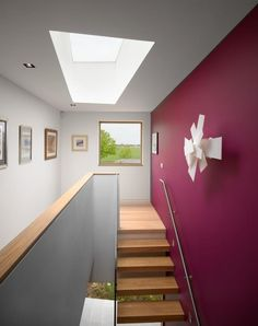 Platform-5-Meadowview-modern-house-stair-hall-with-hanging-paintings-pink-walls