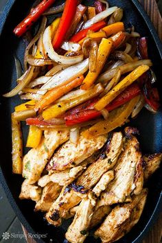 The BEST chicken fajitas! Marinated chicken breasts seared quickly and served with seared onions and bell peppers, served with flour tortillas. On SimplyRecipes.com