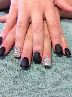 Matte black nails with a touch of bling...
