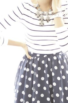 Blue and white polka dots with striped long-sleeved top.
