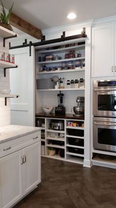 Appliance Garage. Hide all of your appliances. The perfect location for baking, blending, crockpot cooking, juicing, etc.. It keeps the mess out of your main kitchen, and its all concealed behind bypass barn doors.