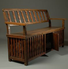 "A ""gallinera"" bench. Philippines, 1880s. Popular during the Spanish colonial period, benches like these were in the foyer of homes. Here visitors waited to see the home owner, stashing their fighting cocks in the space under the seat."