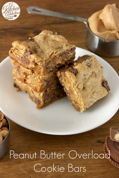 Peanut Butter Overload Cookie Bars - Thick, chewy cookie bars loaded with peanut butter, peanut butter cups, and peanut butter chips! from @Jessica l A Kitchen Addiction