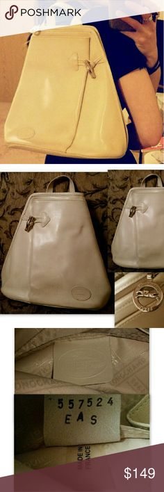 SALE! Longchamp Auth Backpack Handbag Vintage 100% Authentic Vintage Longchamp handbag! From Roseau line, made in France. Magnificent cream leather Longchamp handbag in backpack style. Finely crafted silver tone logo hardware.  Features outer pocket with toggle hardware, two inside slip pockets. Signature logo print lining. Side and top zip around for easy access. Slender and comfortable adjustable straps. Can be worn backpack style or over the shoulder. Overall great condition with some…