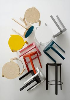 Spin – Staffan Holm  Spin now in colours. A development of the Spin stool, which was awarded the Furniture of the Year award by Swedish magazine Sköna Hem. The low Spin stool now comes in five bright colours; petrol blue, grey, yellow, pink and orange, and naturally natural lacquer, white and black. Spin bar stool with seat height 65 cm, suitable for 90 cm high counters and kitchen islands, comes in the original colours ash wood natural lacquer, white- and black lazur finish.