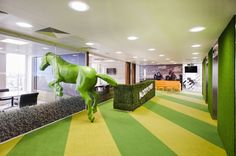 Office Inspiration: @PaddyPower don't do understated. Thankfully for us, their London office is no exception. For starters, it's got a six-foot bright green horse …