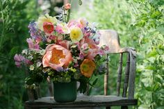cheery colorful spring flower arrangement with poppies | floral design: Floret Flowers