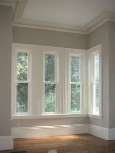 all of my favorite things in one place: hardwood floors; crisp white trim, (tall) baseboards, and crown molding; and beautiful revere pewter walls. love love love!