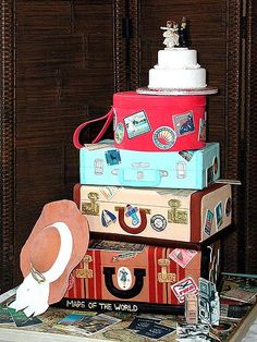 .....promise to love, honor, cherish, and travel.....    This couple is going places! Vintage luggage, maps, train tickets, postcards, wedding photos, and travel stickers recalling places visited. And topping it off, a miniature wedding cake with antique bride and groom.