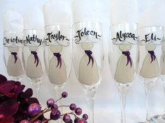 Personalized Bridesmaid Glasses – Hand Painted to replicate the details of your wedding gown, bridesmaid dresses, tuxes flowers and other details of your wedding  {www.samdesigns.net} , $20 ea.
