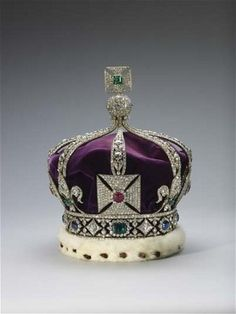 Imperial Crown of India. The crown jewels signify royal authority to lead and protect the nation. The crown, designed by Garrard & Co, was created for George V to wear at the Delhi Durbar of 1911, as it is forbidden for crown jewels to leave Britain. It is set with one large ruby, 6 100 diamonds, rubies, emeralds and sapphires, and weighs 0.97kg.