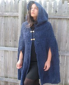 This customizable crocheted cloak is high fashion and old world medieval charm all rolled into one. This item is sure to make you stand out in a crowd and to be one of those fashion staples you turn too again and again.  This cloak is hand stitched using Simply Soft yarn which causes it to drape beautifully. Each square of this cape was individually crocheted and then hand stitched together.