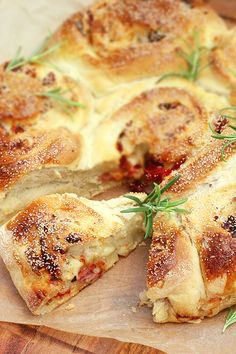 Bread filled with cheese, bacon and sundried tomatoes