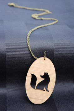 Lasercut fox silhouette necklace by MultiverseDesignsNZ on Etsy https://www.etsy.com/listing/212806698/lasercut-fox-silhouette-necklace