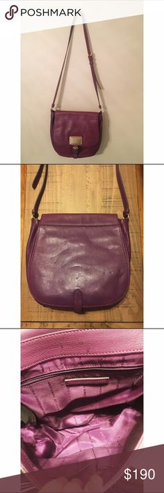 🎉HP - Marc by Marc Jacobs Chain Reaction Calley HP for 11/2 - Best in Bags! 🎉 Leather flap crossbody, gold logo plate, faux buckle hiding metal clasp, logo lining with 3 interior pockets & adjustable shoulder strap. This bag leans towards a more plum color, as opposed to berry. Please notice indentations on purse. Marc by Marc Jacobs Bags Crossbody Bags