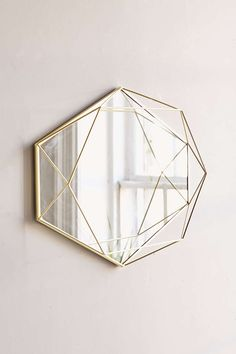 With beautiful geometric lines, Umbra PRISMA MIRROR makes an elegant statement on any wall. Geometric Mirror, Decor, Decorative Pieces, Umbra, Unusual Home, Mirror Wall, Oval Mirror, Metal, Hanging Mirror