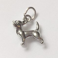 """Just look at the expression on this cute dog! Measures approximately 1/2"""" x 1/2"""". This charm is sterling and comes standard with an """"o"""" ring. You can have the charm soldered at a jeweler's. Or, order"""