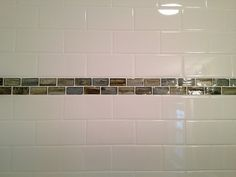 "white 3×6 subway tile shower w/ a 1x2 Vetri ""Safari"" brick glass tile accent band in the South Tampa, Florida"