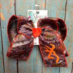Orange trimmed camo bow with browning deer