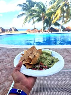 Chips and guacamole, who would love to be sitting in a chair at the pool at Melia Cozumel Beach Resort right about now? ME! Cozumel, Mexico is such a beautiful vacation island @honeyandlimeco
