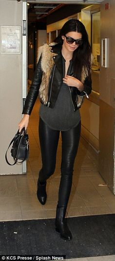 Off duty: The 18-year-old looked the epitome of model chic in a biker jacket, fur gilet and PVC leggings