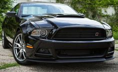 The 2013 Roush RS Mustang adds a touch of Roush flare to the standard Mustang V6.