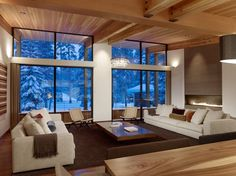 """The Sugar Bowl Residence by John Maniscalco Architecture:  """"The design of this new home in the old village at Sugar Bowl is entirely a product of its dramatic environment. With a snow pack of as much as 8-9 feet, massive snow loads, and dangerous shear snow blocks dropping from typical sloped roofs, the site conditions dictate design.  This new house uses the constraints to shape an elegant solution."""""""