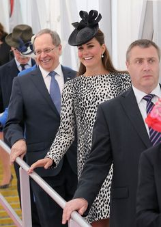 President and CEO of Princess Cruises Alan Buckelew (L) escorts Catherine, Duchess of Cambridge as she walks down the gangplank disembarking the Royal Princess after receiveing a tour on board after the Princess Cruises ship naming ceremony at Ocean Terminal on June 13, 2013