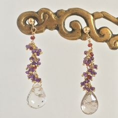 Dancing Amulets: Rutilated Quartz with amethyst and garnets. Liked by AmédéeStyle