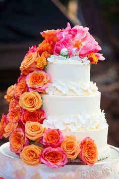 Bright wedding cake idea - three-tier wedding cake with pink + orange roses and sugar flowers - perfect wedding cake for a destination wedding {MeewMeew Studios}