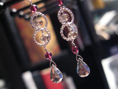 Handmade hammered sterling silver teardrops, garnets, Swarovski crystals ss earrings.