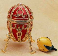 1895 Rosebud Egg. Red enamel with gold and diamonds. The egg opens to reveal a hinged yellow rosebud, another symbol of the couple's love for one another.