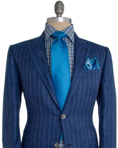 """Kiton Blue Stripe Suit 2 button jacket Notch lapel Navy melton Flap pockets Front left chest pocket Fully lined Purple lining Double vent Flat front pant Zip fly 3 button close Double welt button back pockets Coin pocket 10"""" rise 8"""" hem opening 75% cashmere, 15% linen, 10% silk Handmade in Italy"""