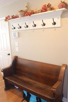 We've been doing some decorating around the house - toy storage and gallery wall in the living room, coat hooks and a church pew in the entry. Church Pew Bench, Church Foyer, Church Pews, Vestibule, Foyer Design, Hallway Designs, Entry Hall, Front Entry, Foyer Decorating