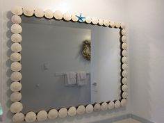 My latest project:  Mirror from St. Vinnys: 20.00  Sand Dollars picked up walking 200 miles on the beach - great excercise  A glass sea star given to me by a friend made by a local artist - nice finishing touch.  The look:  Priceless