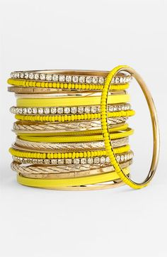 OOhh.... I'd love to carry a bit of sunshine on my wrist with these fun bangles.  Maybe I can mix some of these up with the fuchsia ones? Hmm...