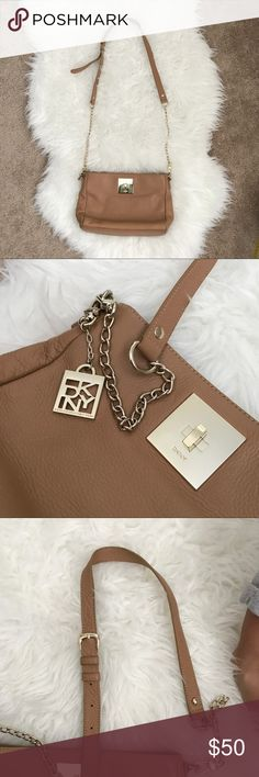 DKNY Soft Genuine Leather Crossbody Bag This is a beautiful tan with gold accents cross body bag.  It's in great condition.  Clean inside and out. Details shown in pics. There's a minor scuff on the right lower front of the bag, shown in pic. I may have bumped it somewhere. The strap is adjustable. Measures approximately 11 x 8. DKNY Bags Crossbody Bags