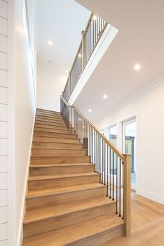 White Oak Staircase The staircase features White Oak threads custom stained to match the hardwood flooring metal spindles and White Oak railing and baluster Oak Stairs, Staircase Railings, Modern Staircase, House Stairs, Staircase Design, Stained Staircase, Staircases, Hardwood Stairs, Stair Design